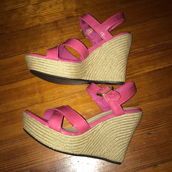 Pink UGG wedge shoes.